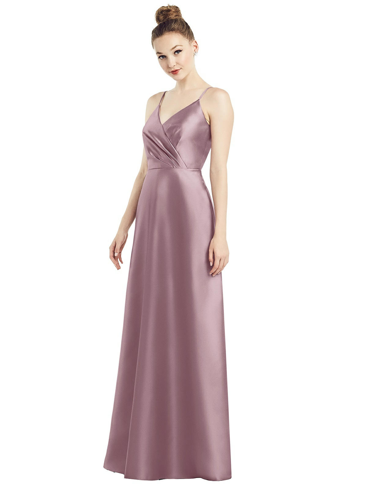 Floor length satin twill bridesmaid gown. Featuring an A-line skirt and a faux wrap bodice. Shown in colour Dusty Rose.