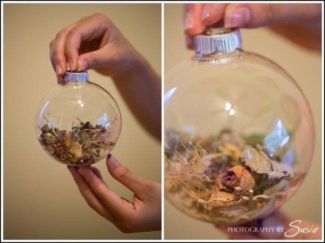 Dried flowers from bouquet put into globe type glass container for display