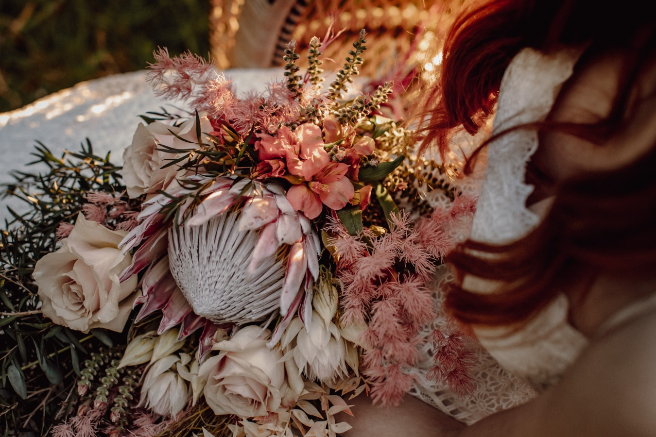 Close up of bouquet in bride's lap