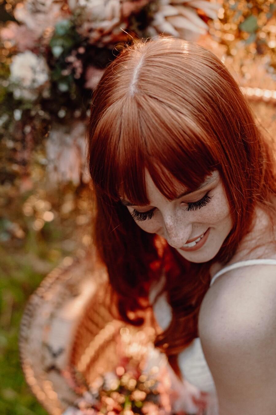 Close up of bride smiling over shoulder