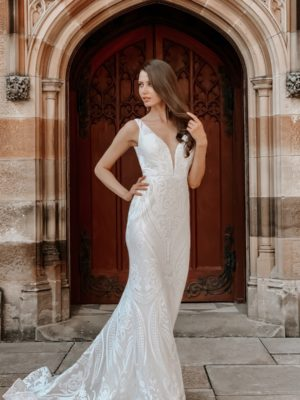 Tina Holly Bridal - Wedding gown BA109 with trumpet silhouette and plunging v-neck with a chapel train in off white front view