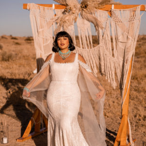 Roz La Kelin Bridal - Wedding gown Cosmopolitan Set - allover lace trumpet gown with detachable cape sleeves and a square neckline - Front view